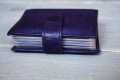 Violet leather card holder Stock Image