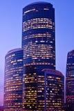 Violet-light modern skyscrapers Stock Photos