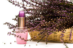Violet lipstick and flowers Royalty Free Stock Image