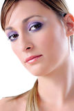 Violet look. Young beautiful woman, close up, wearing evening make-up with violet eyeshadow Royalty Free Stock Photography