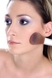 Violet look-step 3-blusher. Young woman, close up, applyiing blusher Stock Photos