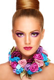 Violet make-up. Portrait of young beautiful tanned girl with stylish violet make-up and fancy necklace, on white background Stock Photos