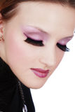 Violet makeup. Close-up portrait of beautiful girl with trendy makeup in violet colors and huge false lashes Stock Image