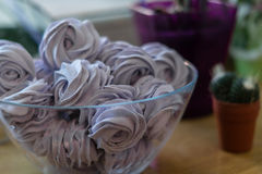Violet marshmallow in form of rose. In a large glass bowl Royalty Free Stock Images
