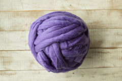 Violet merino wool ball Royalty Free Stock Image