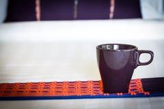 Violet mug on bed Royalty Free Stock Images