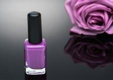 Violet nail polish and rose Royalty Free Stock Photos