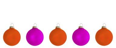 Violet and orange Christmas tree balls. Against white background Stock Photos