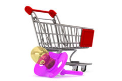 Violet pacifier in shopping cart Royalty Free Stock Photography
