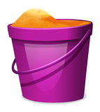 A violet pail with sand Royalty Free Stock Images