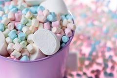 Violet pail with various marshmallows. Stock Photos