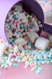 Violet pail with various marshmallows. Stock Images