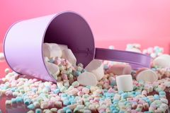 Violet pail with various marshmallows. Royalty Free Stock Image