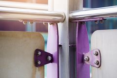 Violet painted metal sheets fastened with bolts and stainless nu. Ts. It is some rust stock image