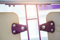 Violet painted metal sheets fastened with bolts and stainless nu. Ts. It is some rust royalty free stock image