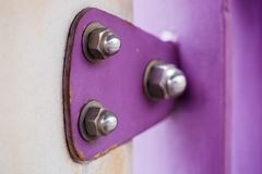 Violet painted metal sheets fastened with bolts and stainless nu. Ts. It is some rust stock images