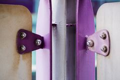Violet painted metal sheets fastened with bolts and stainless nu. Ts. It is some rust stock photos