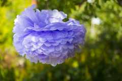 The violet paper flower hanging on the tree Royalty Free Stock Photography