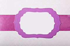 Violet paper frame with ribbon Stock Image