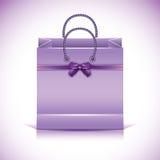 Violet paper shopping bag Stock Photos
