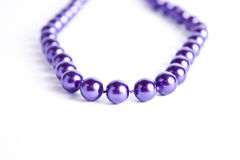 Violet pearl necklace Royalty Free Stock Images