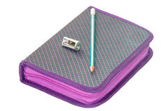 VIOLET PENCIL BOX WITH WOODEN PENCIL AND SHARPENER Royalty Free Stock Photography
