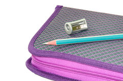 VIOLET PENCIL BOX WITH WOODEN PENCIL AND SHARPENER Royalty Free Stock Image