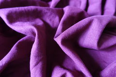 Violet linen fabric with folds and shadows. Violet plain linen fabric with folds and shadows Stock Photos
