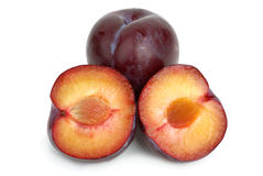Violet plums: whole and two halves Stock Image