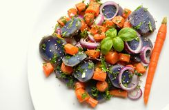 Violet potato and carrot salad with onion Royalty Free Stock Photography