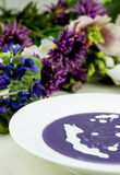 Violet potato and leek soup with cream Stock Images