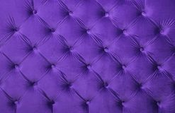 Violet capitone tufted fabric upholstery texture. Violet purple velvet capitone textile background, retro Chesterfield style checkered soft tufted fabric Stock Photography