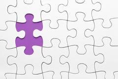 Violet puzzle piece missing. White puzzle piece missing on violet background stock images