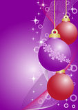 Violet and red christmas balls. Three violet and red christmas balls on violet background Stock Photography