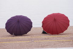 Violet and red umbrellas in Thessaloniki Stock Image