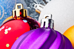 Violet, red, white and gold balls Stock Images