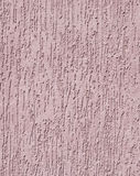 Violet relief plaster on wall closeup Stock Photo