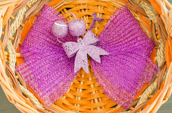 Violet ribbon in basket. Background Stock Photography