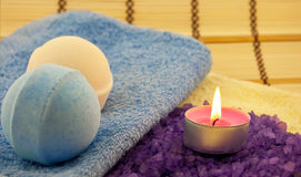 Violet  salt with candle Royalty Free Stock Image