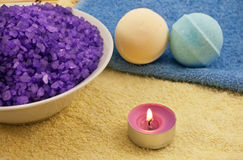 Violet  salt with candle and bath balls Stock Photos