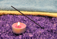 Violet  salt with candle and insense stick Stock Images