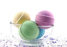 Violet  salt and multicoloured bath balls Royalty Free Stock Photography