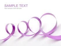 Violet satin ribbon Stock Photos