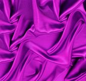 Violet satin or silk fabric close up stock photo