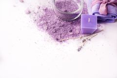 Violet sea salt Spa. Purple salt, dried lavender flowers. Place for your writing on a white background Royalty Free Stock Image