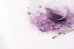 Violet sea salt Spa. Purple salt, dried lavender flowers. Place for your writing on a white background Stock Photography