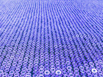 Violet sequins embroidered background Stock Photo
