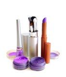 Violet set for make-up. (brushes, eyeshadows, rouge, nail polish and lipstick Stock Photo