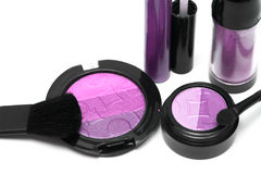 Violet set for make-up. Eyeshadows, rouge, blusher and gloss Stock Images