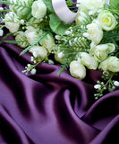 Violet Silk and White Roses Stock Images